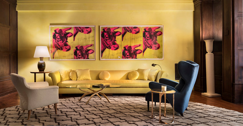 Photo of Andy Warhol's 1966 Day-Glo chartreuse and hot pink cow-head wallpaper