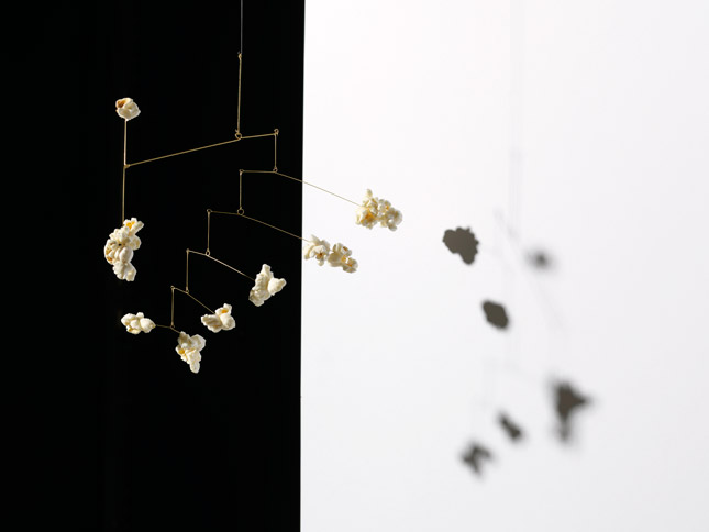 Image of Hanging Mobile made with popcorn by Carl Kleiner in an homage to Alexander Calder