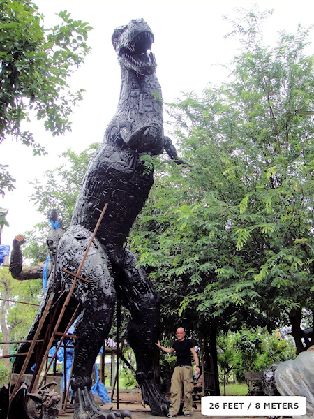 Dinosaur sculpture made from recycled metal by Tom Samui