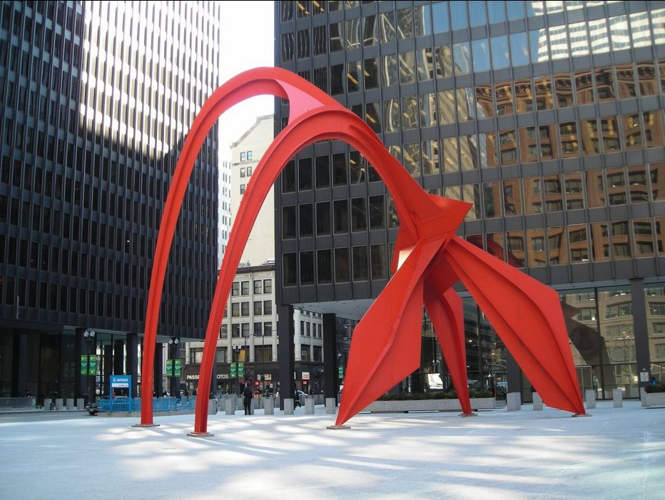 Photo of Flamingo sculpture, created by noted American artist Alexander Calder, a giant 53 foot (16 m) tall stabile located in the Federal Plaza in front of the Kluczynski Federal Building in Chicago, Illinois, United States