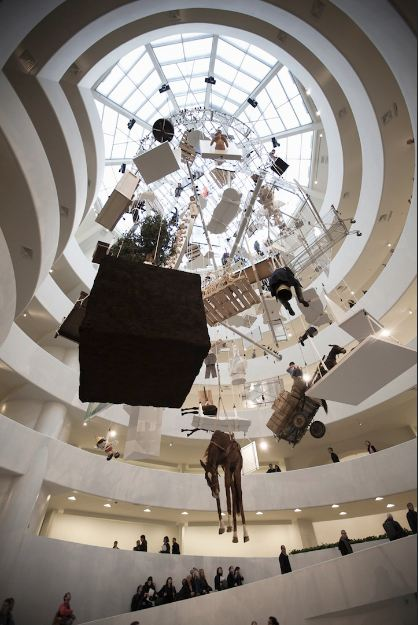 Image of hanging sculpture mobile Maurizio Cattelan guggenheim
