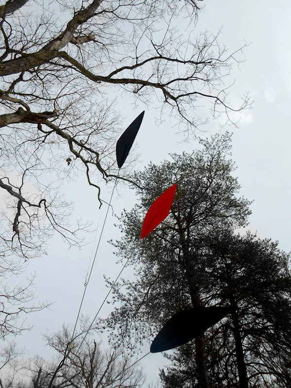 Photo of tall mobiles with trees and sky